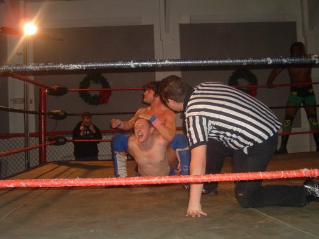 Mike Sydal works over K.C. Karrington in tag team action.