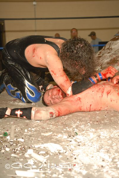 "This was the easiest to chose, of all the shots taken in 2008 this Weapons Match between Chris Havis and Stephen Saint will forever be in my conversation of ""what  are some of your best shots"". September 21, 2008 Malicious Mayhem… would be the #1 Choice of my Best PWP Shots of 2008.- Gary Giaffoglione/GG HotShots.com PWP Photographer"
