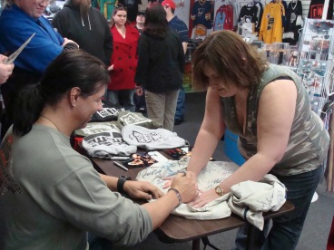 Superfan and Former Independent Valet Barbie Shultz has her autograph jacket signed by Al Snow.