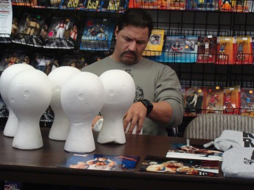 Al Snow signs 'heads' while chatting with the owners of The Fan Shop about the local wrestling scene, as well as the goings on in WWE and TNA.