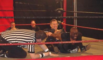 Dingo stretches Shorty Biggs as Ref Eric Davis ask if Biggs wants to quit- Photo Credit Kari Williams