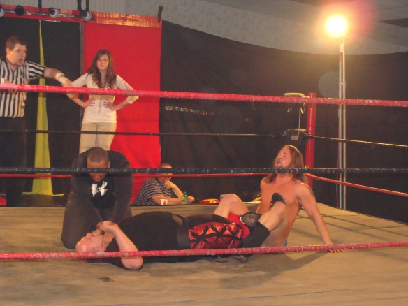 The devil herself makes Jordan Lacey  pay with trusting her earlier as Dorian Victor and Mark Sterling ambushes the former LWA Champion –Photo Credit Kari Williams