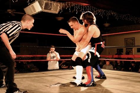 Adam Rich struggles to get out of the grip of  Pierre Abernathy (Photo Credit: Michael R Van Hoogstraat)