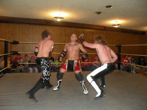 "The Unbreakable"" Zach Thompson and. Evan Money double teams into the MWR January Wrestler of the Month Bailey Mannix (Photo Credit Brian Kelley)"