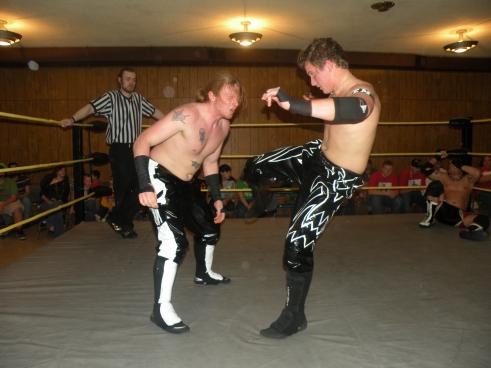 Evan Money swift kicks punish Zach Thompson.(Photo Credit Brian Kelley)