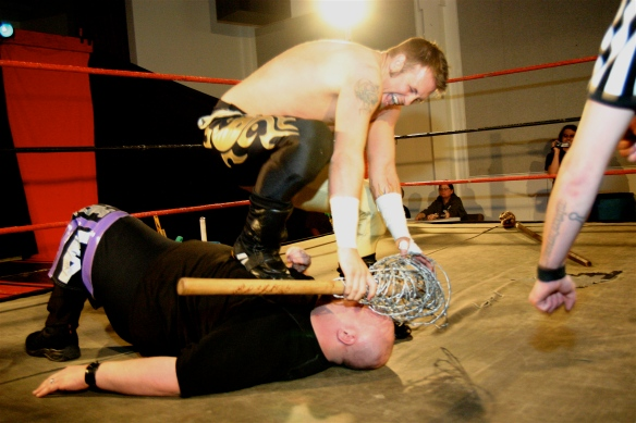 "Jeremy Wyatt went to all expense to keep his LWA Title against Jordan Lacey  in their ""Fans bring the weapons match"" ( Photo Credit Mike Van Hoogstraat)"