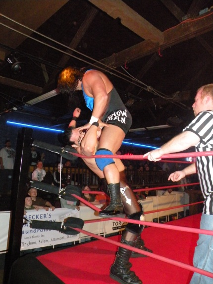 Al Snow brings a flurry of punches in the corner.