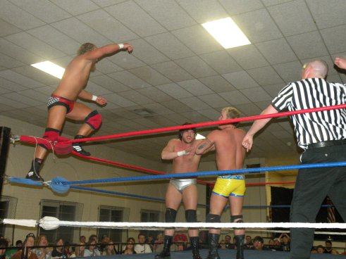 The tag team Champions Darin Wade and Dustin Lane works over Brian Breaker (Photo Credit Paul Alberson)