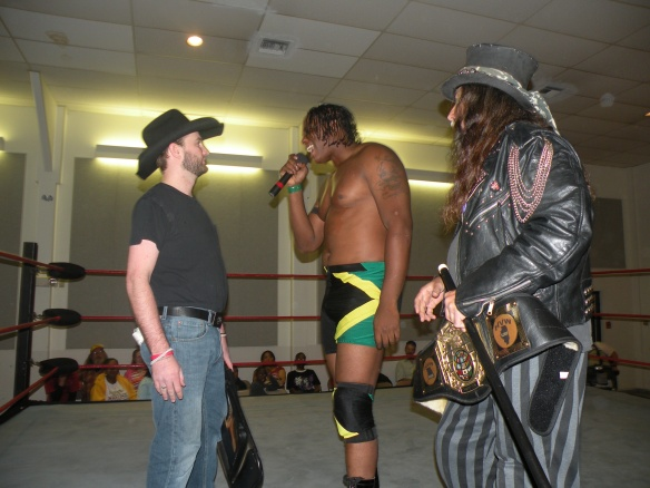 "Donovan Ruddick along with his manager The Magic Man forewarns AWR'S Matt Krueger to get out of his ring.  (Photo Credit Brian ""Flair"" Kelley)"