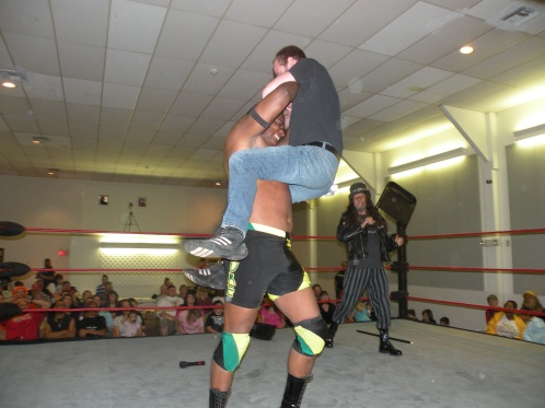 "Matt Kruger goes for a ride for his trouble as the High Voltage Champion sends a message to Absolute Wrestling Radio's Mark Bland. (Photo Credit Brian ""Flair"" Kelley)"