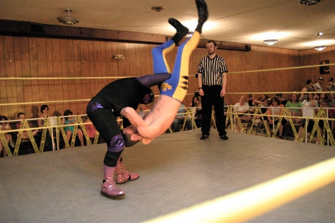 Brimstone body slams Slade with force. (Photo Credit: Mike Van Hoogstraat)