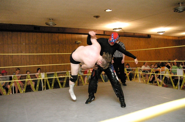 Rebel Lucha tosses Fantabulous (Photo Credit: Mike Van Hoogstraat)