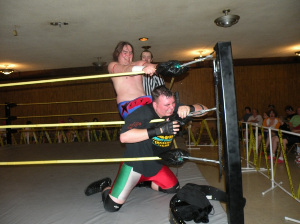 """The Rockstar"" Jimmy Rockwell chokes Brian Scrilla in the corner (Photo Credit: Brian Kelley)"