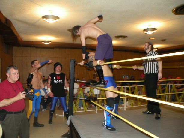 Krotch works over Ricky Kwong in the corner while Rockwell and Slade look on (Photo Credit: Brian Kelley