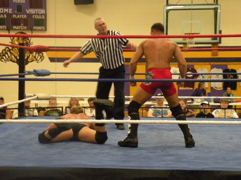 "The Refs eyes says it all in this picture as Anthony works over Jones (Photo Credit: Brian ""Flair"" Kelley)"