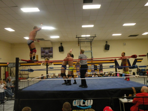 """Darin Waid goes to the top as his tag team partner Dustin Lane holds him in place. Perfect Tag Team action.(Photo Credit: Brian """"Flair"""" Kelley)"""
