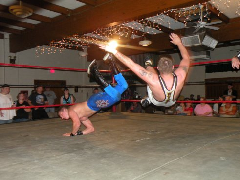 "Bodies hit the floor in the exciting match of the Month when KC Karrington shocked the LWA fans. (Photo Credit Brian ""Flair"" Kelley)"