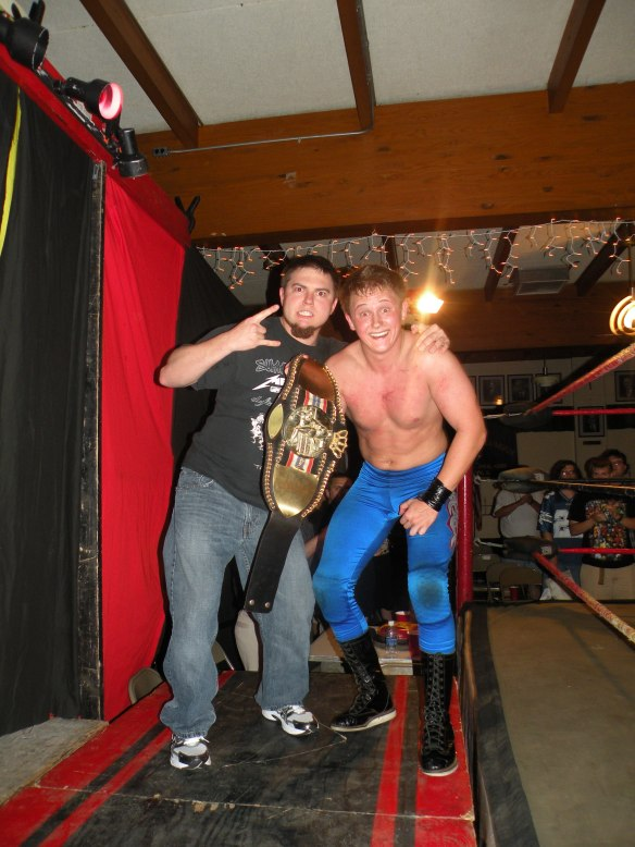 "Ego Express member Steven Kennedy celebrates with tag team partner and good friend Kc Karrington after history was made after Karrington defeated the The Belt collector Jeremy Wyatt. (Photo Credit Brian ""Flair"" Kelley)"