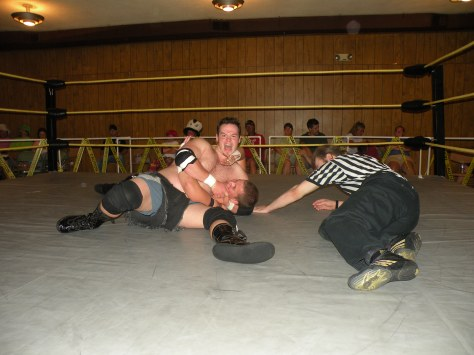 "Dewey Dawson grounds the air attack of Evan Money (Photo Credit Brian ""Flair"" Kelley)"