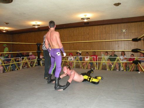 "Ryan Slade steps on the Champion showing no respect. (Photo credit Brian ""Flair"" Kelley)"