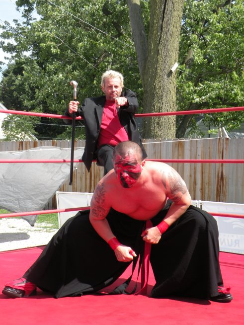 """TNT Keny G leads The International Superstar Kahagas into battle. Managing and promoting Keny has brought excitement throughout the Midwest. (Photo Credit Brian """"Flair"""" Kelley)"""