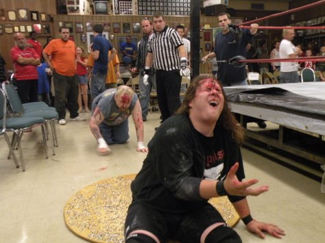 "Ian Rotten stalks Mephisto after he throws him on a board of tacks. (Photo credit Brian ""Flair"" Kelley)"