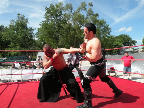 "Bloody Harker Dirge works the arm of the International Superstar (Photo Credit Brian ""Flair"" Kelley)"