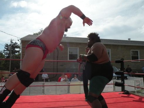 "Walker pulls out all the stops with a a flying shoulder block is . (Photo Credit Brian ""Flair"" Kelley)"