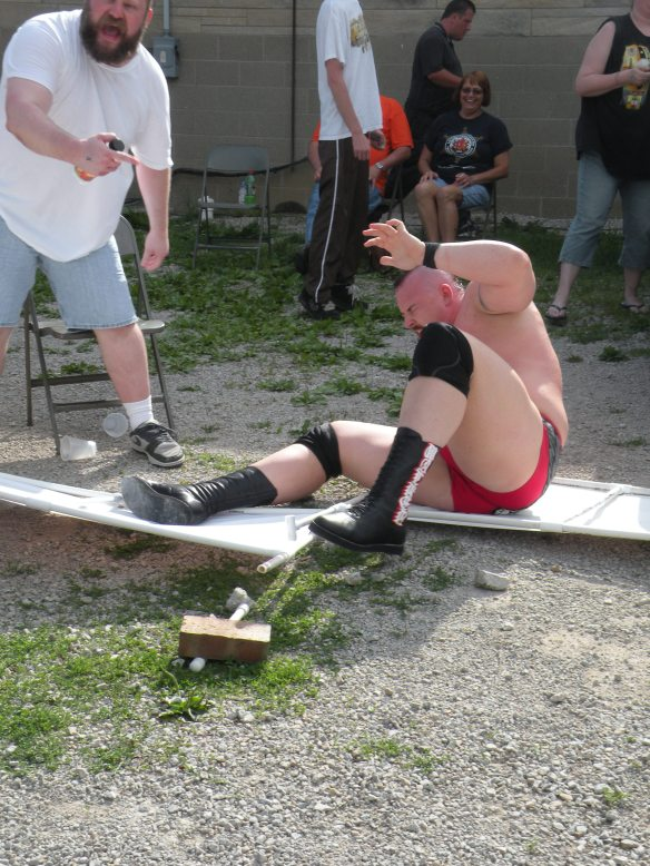"The war raged outside of the ring with the Madman sending Walker into gravel full force  (Photo Credit Brian ""Flair"" Kelley)"