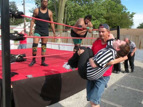 """After Walker speared the female ref, the Future Donovan Ruddick came into to restrain Walker from his destruction. Our hearts to go out to the ref.   (Photo Credit Brian """"Flair"""" Kelley)"""