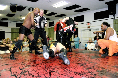 Shaft and newest Connection member Sean Vincent puts the boots to Vaughn who won by DQ(Photo Credit Michael R Van Hoogstraat)