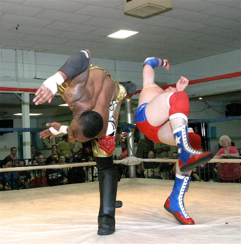 Johnny Courageous  suffers a leg injury that cost him the match but AJ Williams shows the heart of a Champion by helping him out of the ring. (Photo by Michael R Van Hoogstraat)