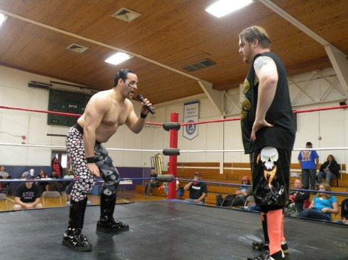 "Bloody Harker Dirge lets GAW CS Champ Kenny O' Brien know that he is in for a fight. (Photo Credit Brian ""Flair"" Kelley)"