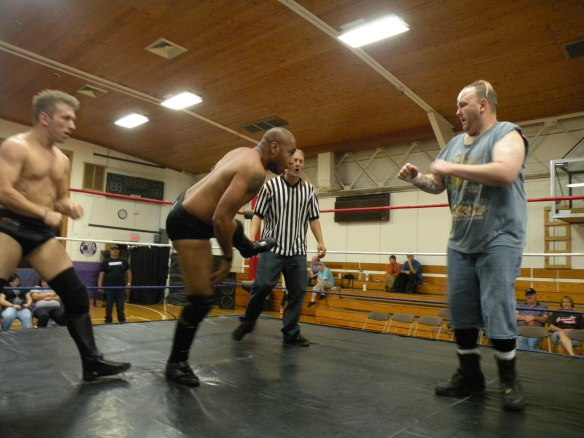 "Dingo and Ian Rotten plays catch with Cages head.(Photo Credit Brian ""Flair"" Kelley)"