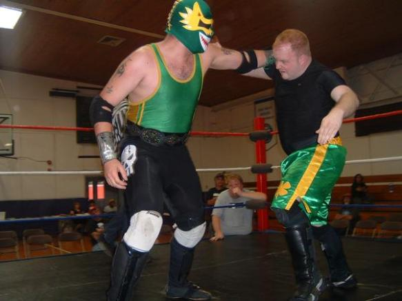 "Dragon Verde slugs it out with Conner Riley.(Photo Credit Brian ""Flair"" Kelley)"