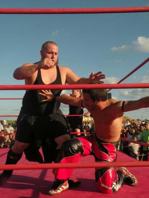 "Brett Gakiya looks for get breathing room from The Hooligans(Photo Credit Brian ""Flair"" Kelley"