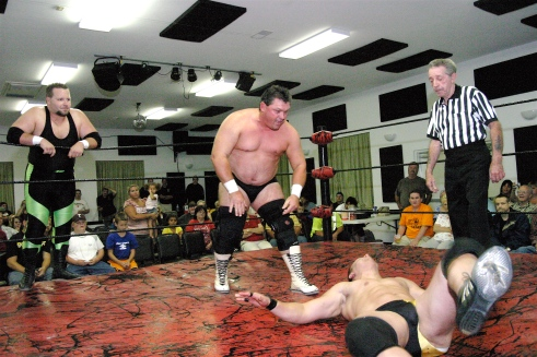 Keith Smith bodyslams Dave Vaughn. (Photo Credit Michael R Van Hoogstraat)