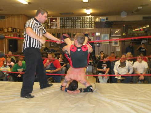 "Sean Vincent has Billy McNeil painfully  twisted in the ropes (Photo Credit Brian ""Flair"" Kelley)"