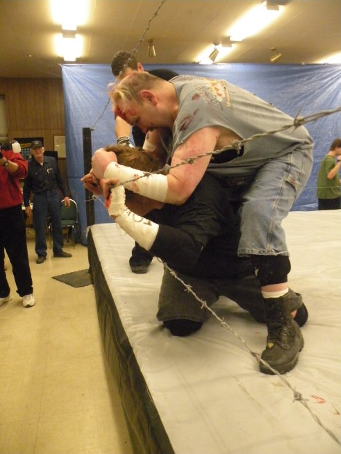 "Ian Rotten tortures Mephisto with Barb Wire(Photo Credit Brian ""Flair"" Kelley)"