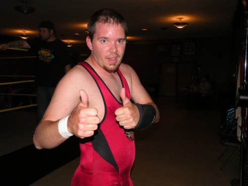 "Aaron Masterson gives a thumbs up after his hard fought victory from Knight Wagner. (Photo Credit Brian ""Flair"" Kelley)"
